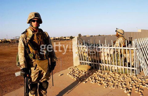 Lieutenant Jason Radion, from Pittsburgh, Pennsylvania, stands beside a position as US Marines of 2nd Battalion 1st Marine Regiment maintain their cordon at the key flashpoint Fallujah railway station on May 6, 2004 in Iraq.
